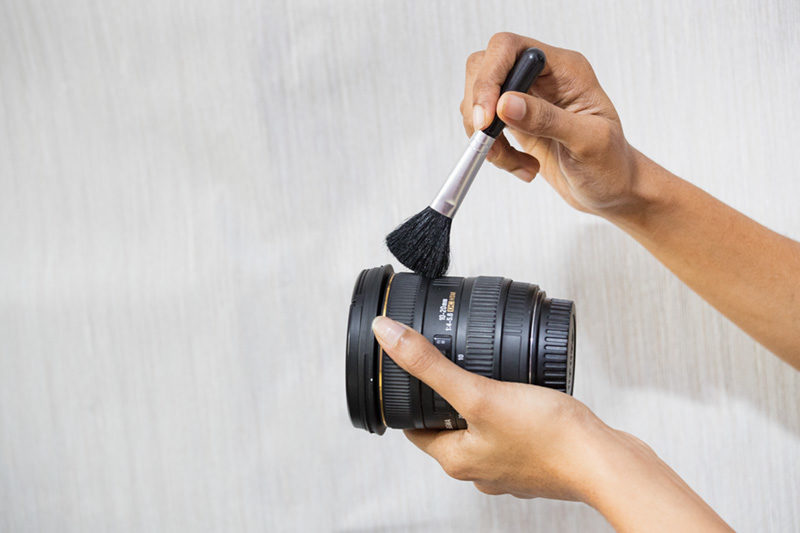 Brush to clean camera lens