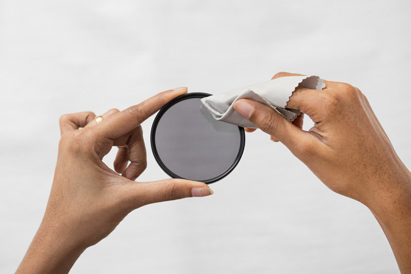Cleaning lens filter with lens cleaning cloth