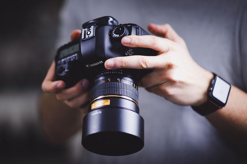 man operating camera