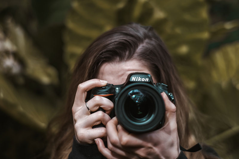 woman doing nature photography